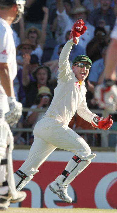 Australian wicketkeeper Brad Haddin celebrates catching England batsman Jonathan Trott off the bowling of Mitchell Johnson on the third day of the third Ashes cricket Test match at the WACA ground in Perth. (AFP Photo)