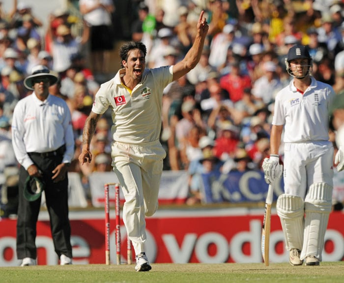 Australian bowler Mitchell Johnson celebrates after taking the wicket of England captain Andrew Strauss on day three of the third Ashes cricket Test at the WACA Ground in Perth. (AFP Photo)