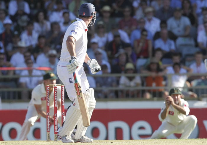 England captain and opening batsman Andrew Strauss edges a ball to be caught by Australian captain Ricky Ponting in the slips on the third day of the third Ashes cricket Test match at the WACA ground in Perth. (AFP Photo)