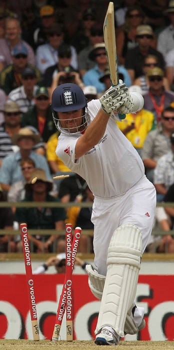 England tailend batsman Graeme Swann is bowled by Mitchell Johnson of Australia on the fourth day of the third Ashes cricket Test match at the WACA ground in Perth. (AFP Photo)