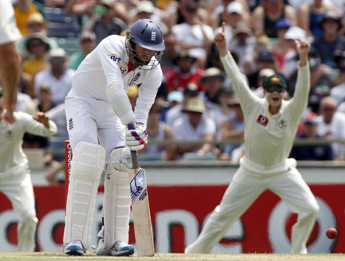 Steven Smith celebrates the fall of England's James Anderson (left) on day four of the third Ashes Test in Perth. (AP Photo)