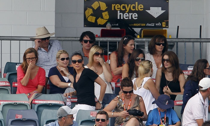 The wives and girlfriends of the English cricket team sit and watch the fourth days play of the Third Ashes Test Match in Perth. (AP Photo)