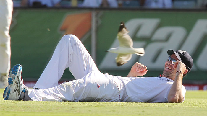 England fast bowler James Anderson lies on the ground after catching Australian batsman Mitchell Johnson during the third Ashes Test at the WACA Ground in Perth. (AFP Photo)