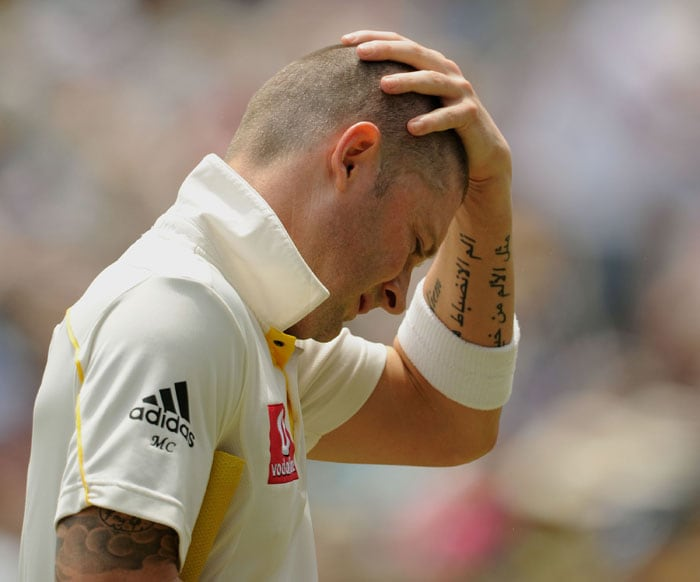 Australian batsman Michael Clarke leaves the ground after being dismissed by England bowler Chris Tremlett for four runs during the third Ashes Test at the WACA Ground in Perth. (AFP Photo)