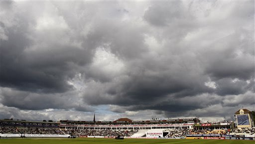 Dark clouds hang over the field of play at Edgbaston cricket ground in Birmingham. (AP Photo)
