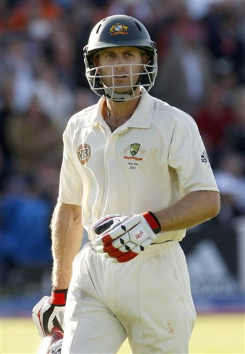 Simon Katich leaves the field after being bowled LBW by Graeme Swann on the first day of the third Test between England and Australia in Birmingham. (AP Photo)