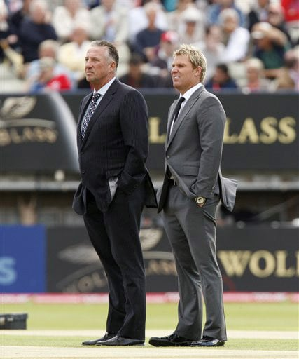 Former cricketers Ian Botham and Shane Warne are seen as rain delays play on the first day of the third Test between England and Australia in Birmingham. (AP Photo)