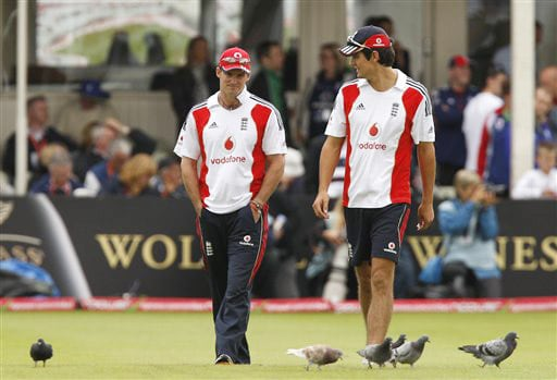 Andrew Strauss and Alastair Cook take a look at the pitch as rain delays play on the first day of the third Test between England and Australia in Birmingham. (AP Photo)