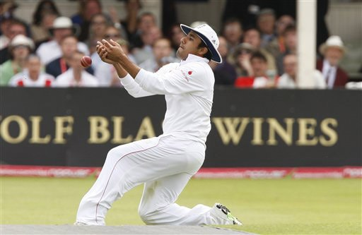 Ravi Bopara drops Nathan Hauritz off the bowling of Graham Onions on Day 2 of the third Test between England and Australia in Birmingham. (AP Photo)