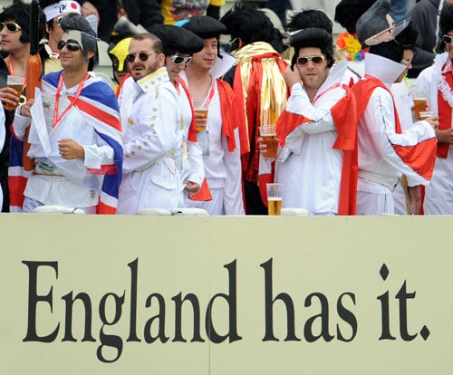 Cricket fans arrive dressed as Elvis Presley as rain delays the start of the third day of the third Ashes Test between England and Australia at Edgbaston. (AFP Photo)