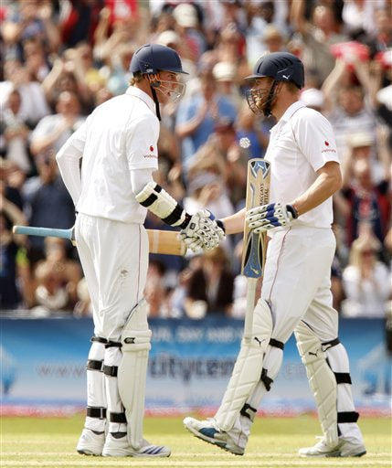 Andrew Flintoff is congratulated by teammate Stuart Broad after reaching 50 on his way to an innings of 74 on Day 4 of the third Test between England and Australia in Birmingham. (AP Photo)