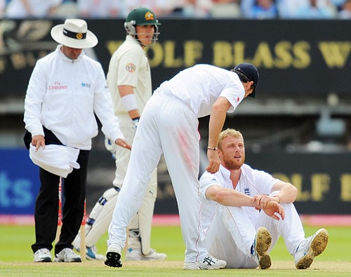 James Anderson checks on Andrew Flintoff after he fell to the ground while bowling on the final day of the third Ashes Test between England and Australia at Edgbaston in Birmingham. (AFP Photo)
