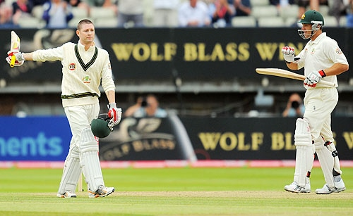 Michael Clarke acknowledges the crowd after taking his runs total to 103 on the fifth day of the third Ashes Test between England and Australia at Edgbaston in Birmingham. (AFP Photo)