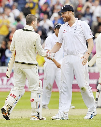 Michael Clarke is congratulated by Andrew Flintoff after scoring his century on the final day of the third Ashes Test between England and Australia at Edgbaston in Birmingham. (AFP Photo)