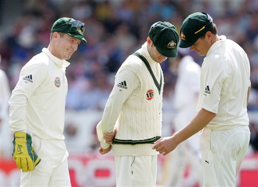 Marcus North shows teammates Michael Clarke and Brad Haddin his wrist after taking a knock on Day 3 of the fourth Test between England and Australia at Headingley in Leeds. (AP Photo)