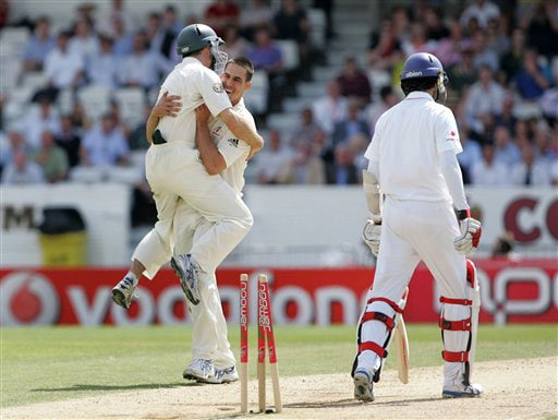 Mitchell Johnson is congratulated by teammate Simon Katich after taking the wicket of Graham Onions on Day 3 of the fourth Test between England and Australia at Headingley in Leeds. (AP Photo)