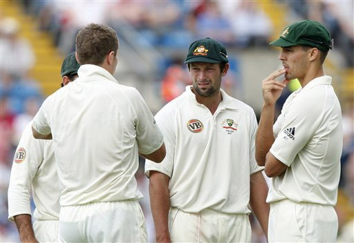 Peter Siddle, Ben Hilfenhaus and Mitchell Johnson discuss tactics on Day 3 of the fourth Test between England and Australia at Headingley in Leeds. (AP Photo)