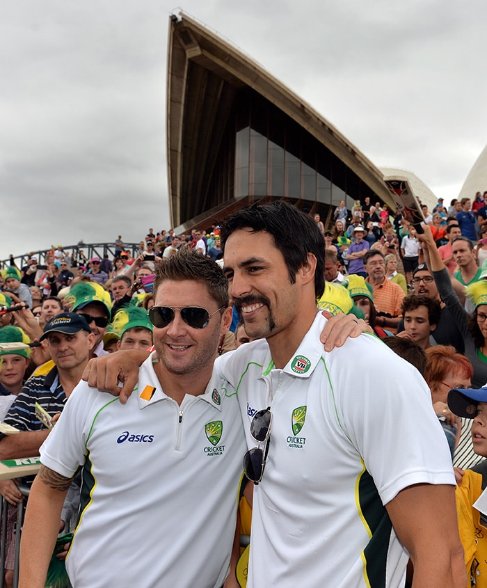 Michael Clarke and Mitchell Johnson arm-in-arm, future Hall of Famers for Australia. (AFP image)