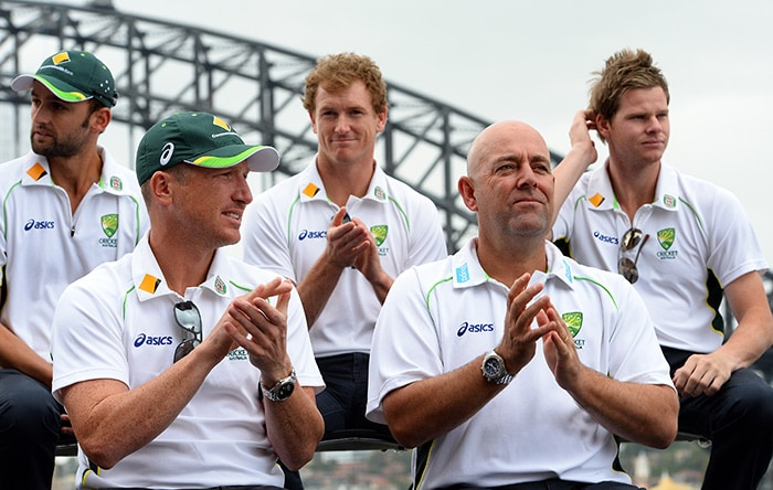 Two senior statesman of the Australia setup, wicketkeeper Brad Haddin and coach Darren Lehmann, soaked in the atmosphere from the sidelines. (AFP image)
