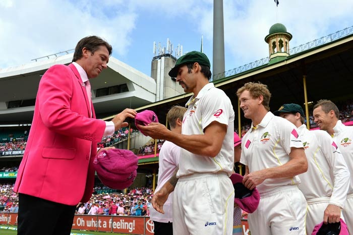 From one speedster to another: Mitchell Johnson and McGrath as lethal as ever, in pink.