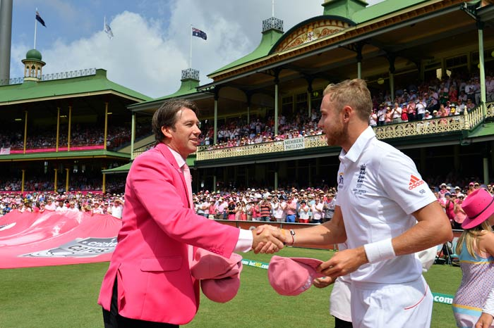 Stuart Broad probably taking bowling advice from a dashing McGrath in pink!