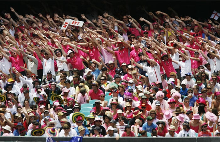 The Barmy Army group of England supports wear pink to show their support for the McGrath Foundation whilst cheering on their team against Australia during the third day of the fifth Ashes Test at the Sydney Cricket Ground (SCG) in Sydney. (AFP Photo)