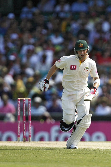 Australia's captain Michael Clarke completes a run during the fourth day of the fifth Ashes Test against England at the Sydney Cricket Ground in Sydney. Australia suffered a chaotic run-out and were 124 for four in their second innings as they struggled to avoid a huge defeat in the final Ashes Test. (AFP Photo)