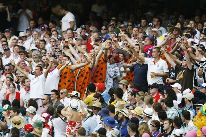 Spectators dressed up in Flintstone costumes cheer on day one of the fifth Ashes cricket Test at the Sydney Cricket Ground. (AFP Photo)