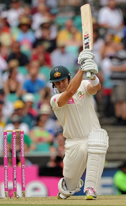 Australian batsman Shane Watson plays a drive on day one of the fifth Ashes cricket Test at the Sydney Cricket Ground. (AFP Photo)