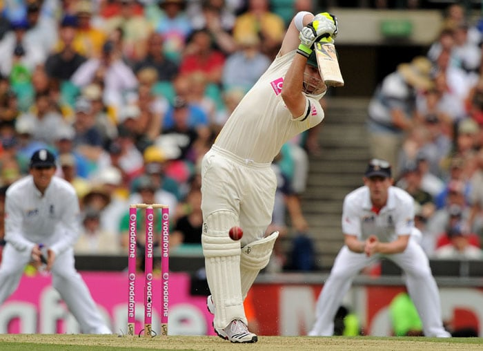 Australian batsman Phillip Hughes drives the ball for four runs on day one of the fifth Ashes cricket Test at the Sydney Cricket Ground. (AFP Photo)