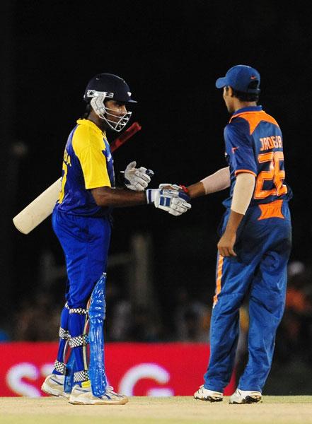 Ravindra Jadeja congratulates Mahela Jayawardene on his team's victory after the sixth ODI of the Asia Cup between Sri Lanka and India at the Rangiri Dambulla International stadium in Dambulla. Sri Lanka won by 7 wickets. (AFP Photo)