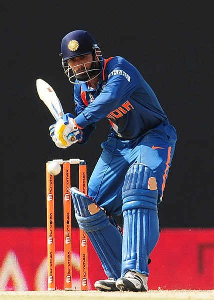 Dinesh Karthik hits a ball during the sixth ODI of the Asia Cup between Sri Lanka and Indian at the Rangiri Dambulla International stadium in Dambulla. (AFP Photo)