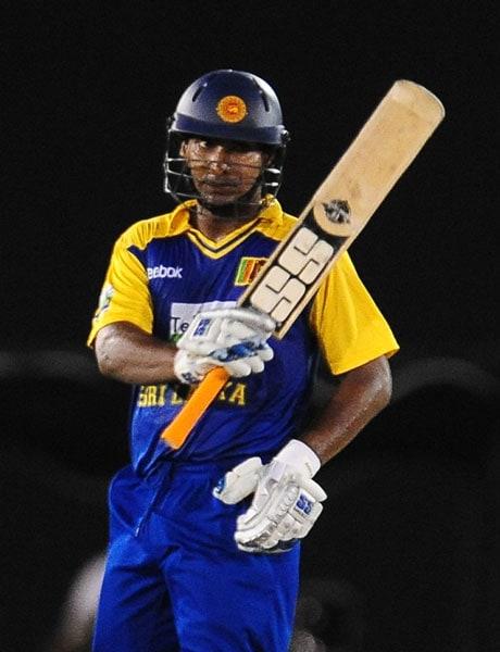 Kumar Sangakkara raises his bat to the crowd after scoring a half-century during the sixth ODI of the Asia Cup between Sri Lanka and Indian at the Rangiri Dambulla International stadium in Dambulla. (AFP Photo)