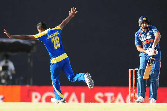 Farveez Maharoof celebrates the hat trick dismissal of Zaheer Khan during the sixth ODI of the Asia Cup between Sri Lanka and Indian at the Rangiri Dambulla International stadium in Dambulla. (AFP Photo)