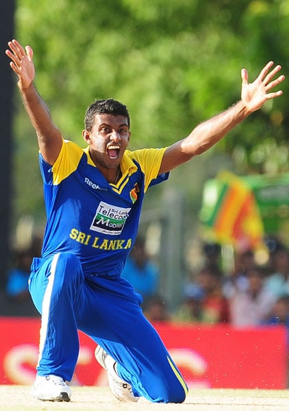 Farveez Maharoof celebrates the dismissal of Ravindra Jadeja during the sixth ODI of the Asia Cup between Sri Lanka and Indian at the Rangiri Dambulla International Cricket stadium in Dambulla. (AFP Photo)