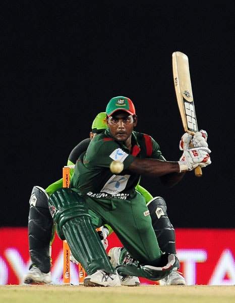 Junaid Siddique plays a shot during the fifth ODI of the Asia Cup between Pakistan and Bangladesh at the Rangiri Dambulla International Cricket stadium in Dambulla. (AFP Photo)