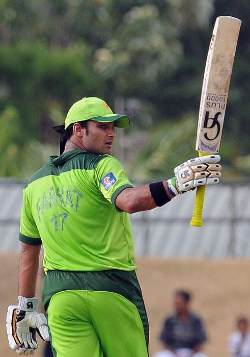 Imran Farhat raises his bat to the crowd after scoring a half-century (50 runs) during the fifth ODI of the Asia Cup between Pakistan and Bangladesh at the Rangiri Dambulla International Cricket stadium in Dambulla. (AFP Photo)