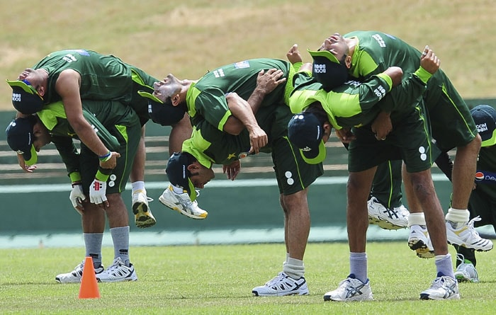 Members of the Pakistan squad stretch during a team practice session at the Rangiri Dambulla International Cricket stadium in Dambulla. (AFP Photo)