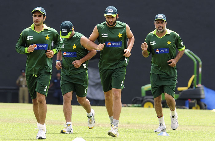 Pakistan captain Shahid Afridi and squad members warm-up during a practice session at the Rangiri Dambulla International Cricket stadium in Dambulla. (AFP Photo)