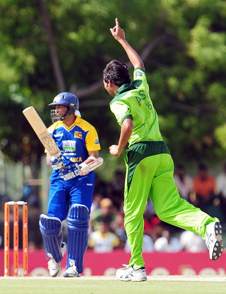 Mohammad Asif celebrates the dismissal of Tillakaratne Dilshan during the first ODI of the Asia Cup. (AFP Photo)