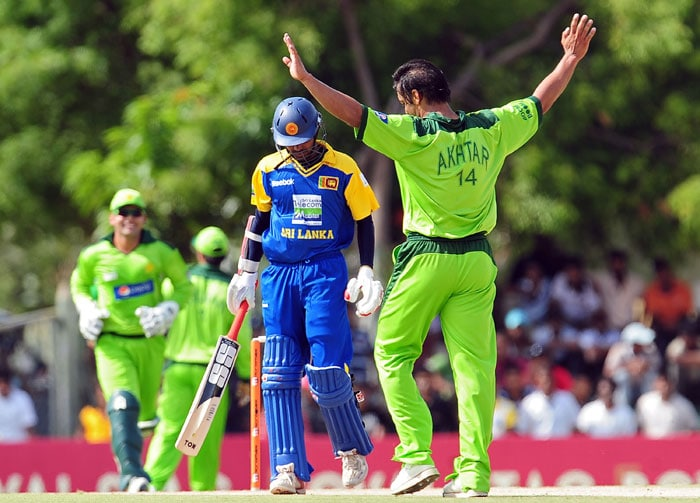 Shoaib Akhtar celebrates the dismissal of Upul Tharanga during the first ODI of the Asia Cup. (AFP Photo)