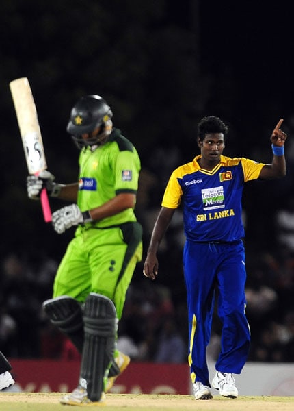 Angelo Mathews celebrates after he dismissed Shahzaib Hasan during the first ODI of the Asia Cup. (AFP Photo)