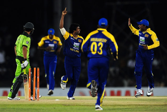 Lasith Malinga celebrates with his teammates after he dismissed Salman Butt during the first ODI of the Asia Cup. (AFP Photo)