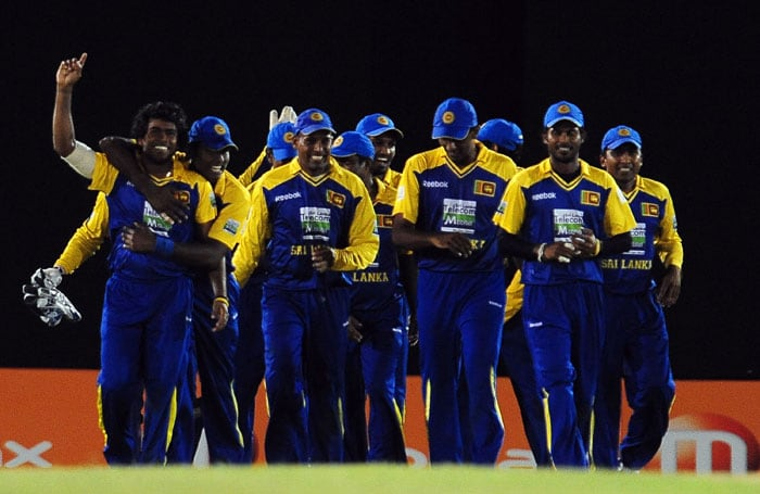 Sri Lankan cricketers leave the ground after victory in the first One Day International cricket match of the Asia Cup between Sri Lanka and Pakistan at the Rangiri Dambulla International Cricket stadium in Dambulla,on June 15, 2010. Sri Lanka beat Pakistan by 16 runs. (AFP PHOTO)