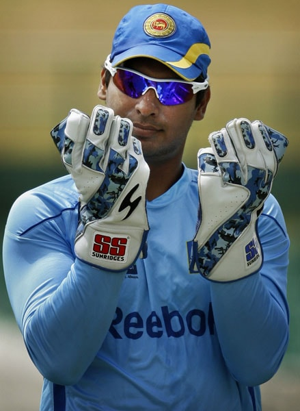Kumar Sangakkara looks at his gloves during a practice session ahead of the Asia Cup match against Pakistan in Dambulla. (AP Photo)