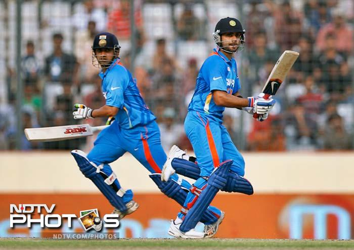 India's Virat Kohli, right, and Gautam Gambhir run between the wickets. The two put up a partnership of 205 runs for the second wicket. (Photo: AP)