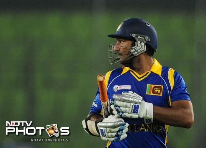 Sri Lankan cricketer Kumar Sangakkara leaves the field following his dismissal. (Photo: AFP)