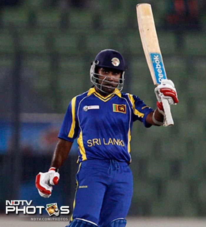 Sri Lanka captain Mahela Jayawardena raises his bat to celebrate scoring a half century. (Photo: AP)