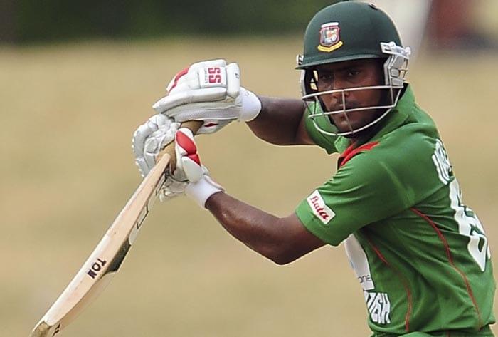 Bangladeshi cricketer Imrul Kayes plays a shot during the second ODI of the Asia Cup, played at the Rangiri Dambulla International Cricket stadium in Dambulla. (AFP Photo)