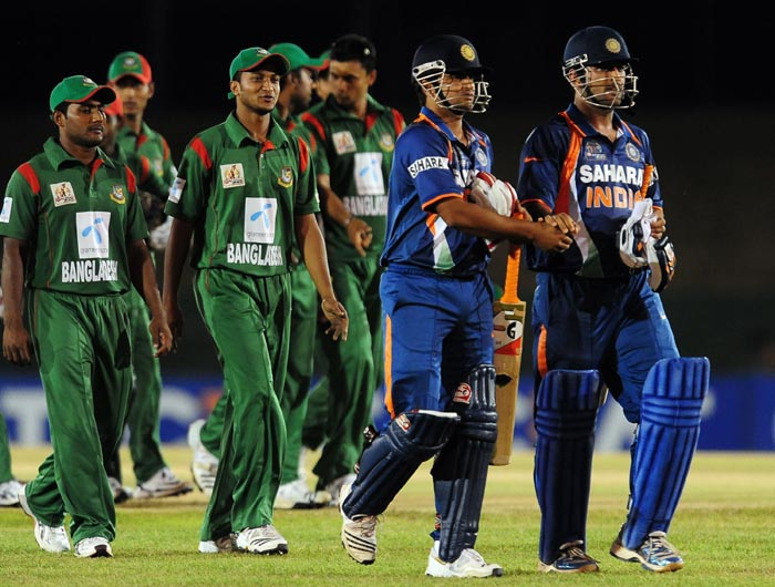 Indian cricket team captain Mahendra Singh Dhoni and teammate Suresh Raina leave the grounds following their victory over Bangladesh in the second ODI of the Asia Cup, played at the Rangiri Dambulla International Cricket stadium in Dambulla. (AFP Photo)